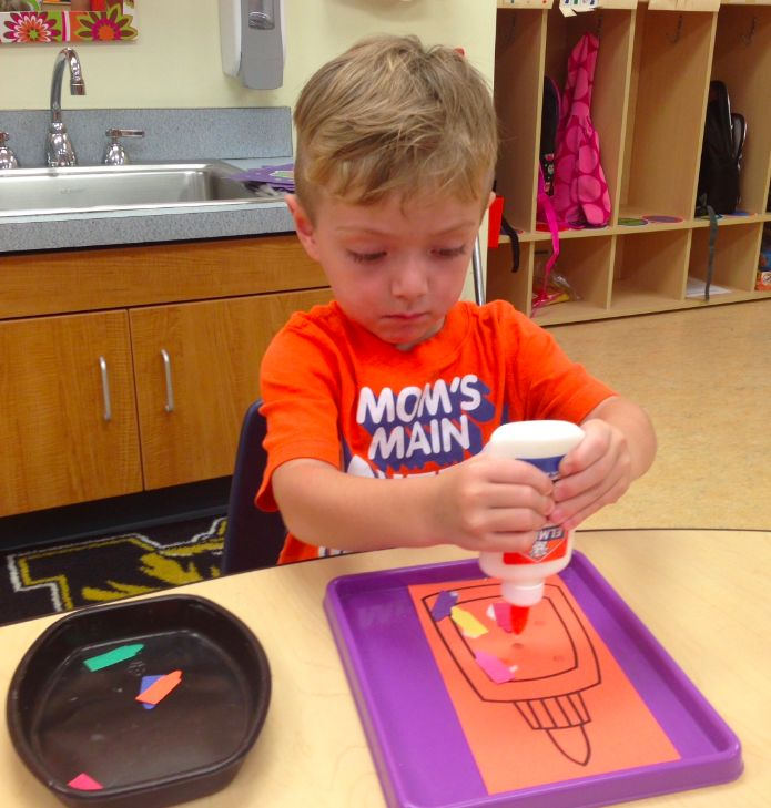 Preschool Wonders: August 2014 learning how to use glue.
