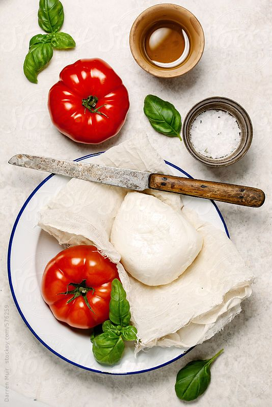 Ingredients to make a Caprese salad on table,seen from above. by DarrenMuir | Stocksy United.Available to licence via #stocksy quote DARRENMUIR20 on checkout for 20% discount. #food #herbs #photography #stock #stocksy #discount #code #basil #mozzarella #caprese #salad #ingredient #stocksyunited