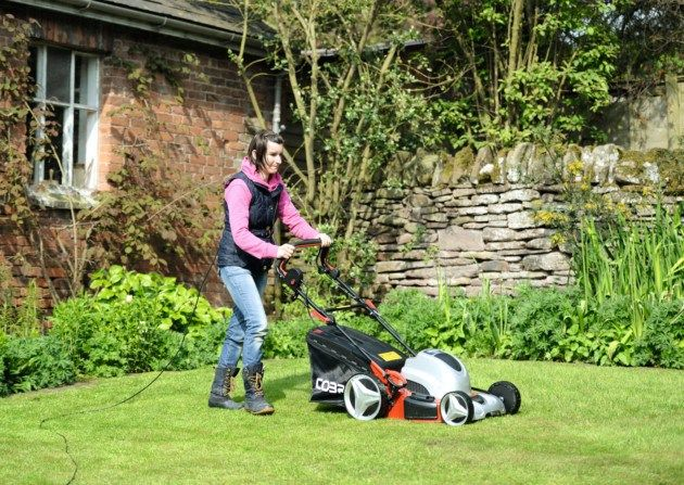 Tamsin tests the Cobra electric rotary mower. Credit: Howard Walker.