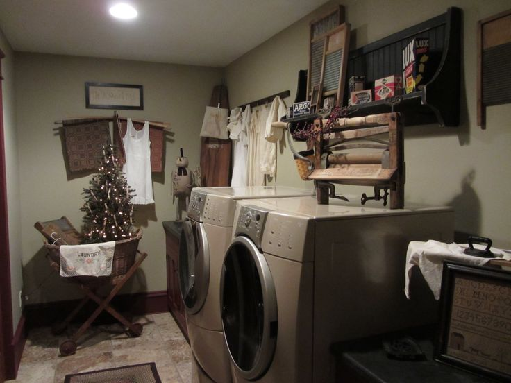 Nicely decorated laundry room.