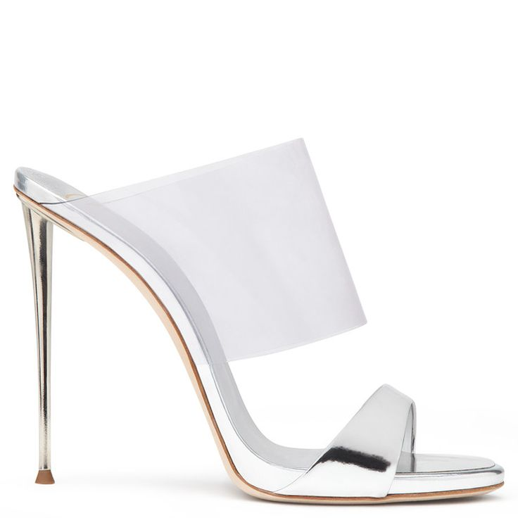 As the foot slips into these shoes, the upper panel appears to melt away,  leaving only the mirrored patent leather strap over the toes and the metal  ...