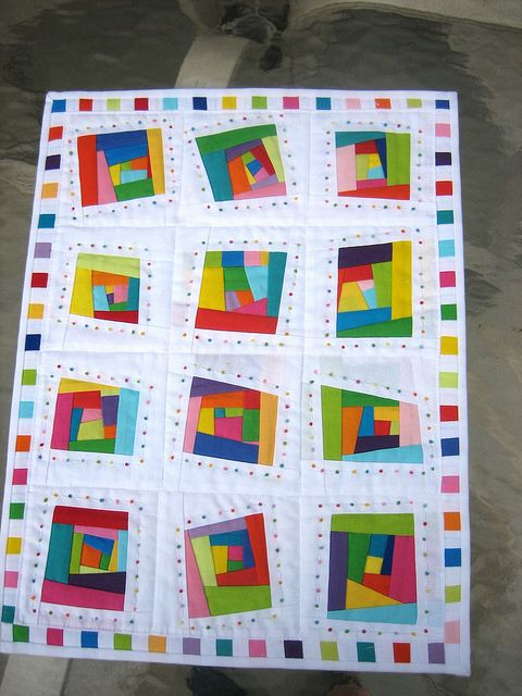 Absolutely love this!  The solids with wonky lines and white ground -- those are the elements that make it perfect for art or baby. It's a doll quilt (13x17), but I'd scale it up to use as a baby quilt. Not sure how to make the dots -- They add a lot but seem to small for appliqué.   Fun and Colorful | Flickr - Photo Sharing!