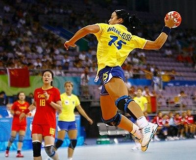 Neli Elisei of Romania takes a shot during their Group A women's handball game against China at the Beijing 2008 Olympic Games August 11, 2008. REUTERSMikhail Voskresenskiy (CHINA)