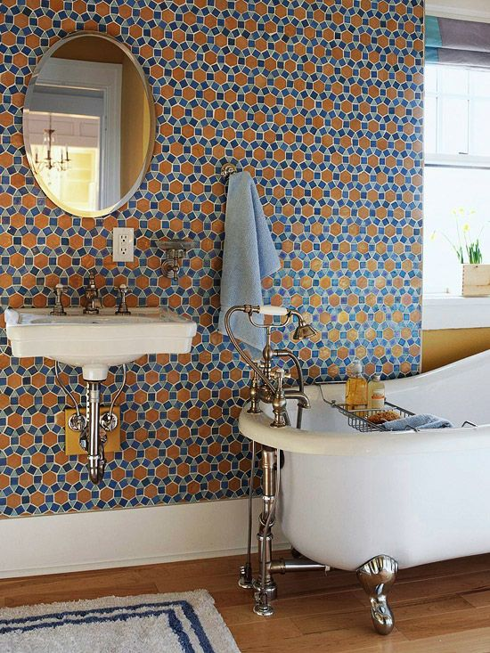We love this white sink with this fun mosaic tiled wall! More bathroom sink ideas: http://www.bhg.com/bathroom/sinks/bathroom-sink-ideas/?socsrc=bhgpin052213blueorangetile=4