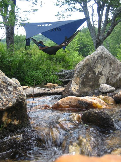Hammock camping.  Ahhh as the sun sets can you imagine the simple sounds of the creek and crickets?  Picturesque and in reach for anyone. :)   Have tarp will camp.