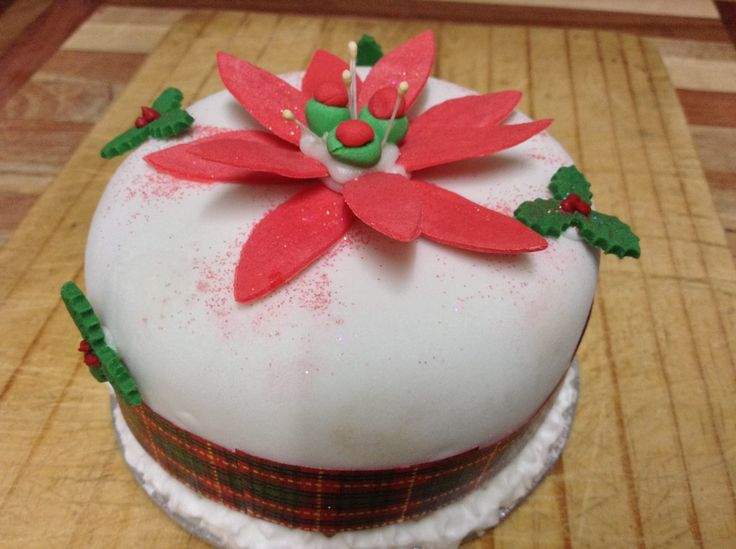 This is a beautiful fruit cake, the size of a tuna tin, hand decorated with hand made flowers.  A wonderful gift for anyone you know