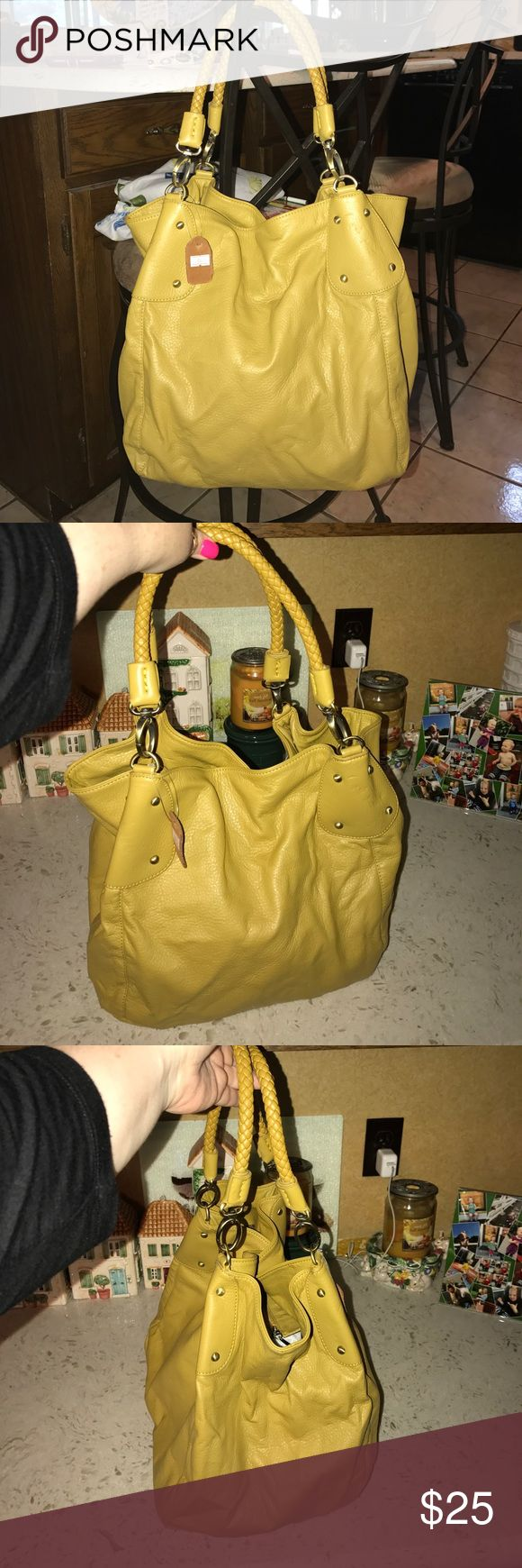 Soft lime slouch bag w/ magnetic close never used Soft lime leather bag with magnetic closure and zipper inside - new never been used - small tag Bags Satchels