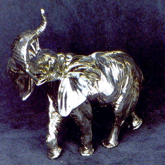 Elephant with proboscis high (CHARM) 925 SILVER Height: 10 cm Width: 9 cm Depth ': 5 cm Weight: 300 gr Dogale Jewellery Venice Italia www.veneziagioielli.com