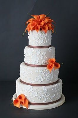 The concept of the lace was thought of as a way of tying the design of the cake into the bride's gown. Each calla lily is hand crafted from sugar and the lace!