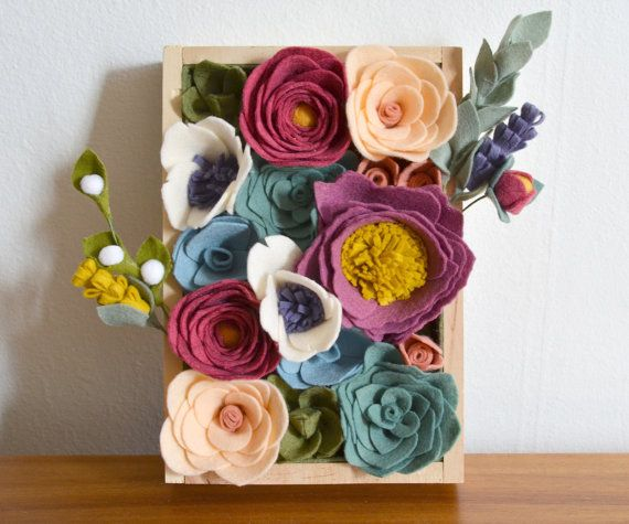 Brighten up your decor with this vibrant felt flower and succulent vertical garden. Made lovingly from high quality wool-blend felt, this flower