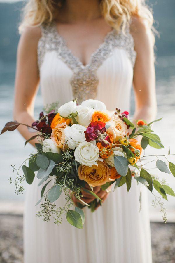 ranunculus and eucalyptus bouquet, photo by Love Me Do Photography http://ruffledblog.com/skaneateles-lake-wedding #flowers #weddingbouquet