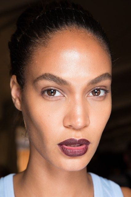 GivenchyThe two models with the biggest gowns on the catwalk were given a bold berry lip instead - including lipstick lover Joan Smalls.