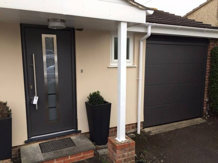 Hormann TPS 700 steel front door with long bar handle and chrome surround and a matching L ribbed Hormann sectional garage door insulated and remote control