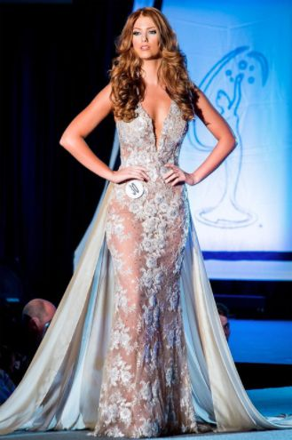 Cassandra Angst wore this stunning nude illusion embroidered gown at the Miss Pennsylvania USA 2017 pageant! Cassandra will be representing Pennsylvania later this year at Miss USA 2017.  The Color  I love the simplicity of the nude and off-white coloring of this gown. It makes the overall look emanate a sense of fresh style and sophistication.  The gorgeous details throughout the bodice of the gown that trickle downwards throughout the skirt take the look from runway to pageant-appropriate…