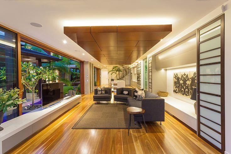 recessed lighting behind floating wood ceiling