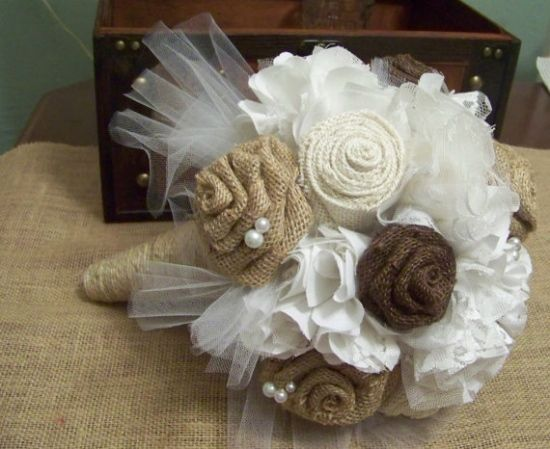 To really amp up your rustic celebration, choose burlap flowers to carry with you. This fun charming touch is perfect for the country girl!  Burlap Flowers