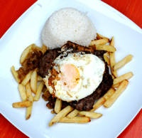 "The basic elements of bistec a lo pobre are steak, fried potatoes, fried onions, and fried eggs. The name roughly translates to ""poor man's steak."""