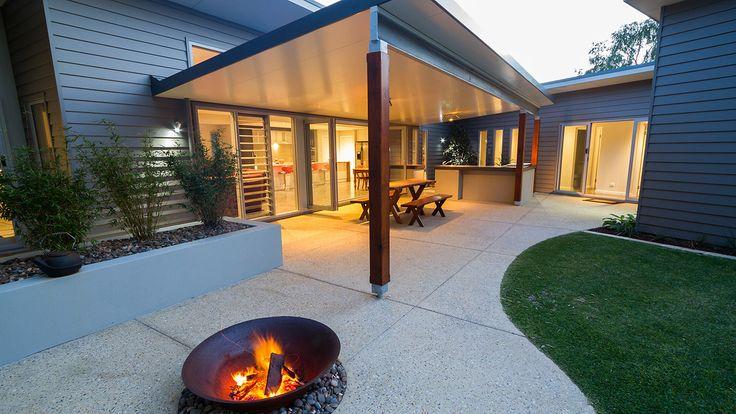 Patio Design, Courtyard Design, rear patio design, architecture, James Hardie cladding, fire pit, rustic backyard design, outdoor kitchen, timber patio beams