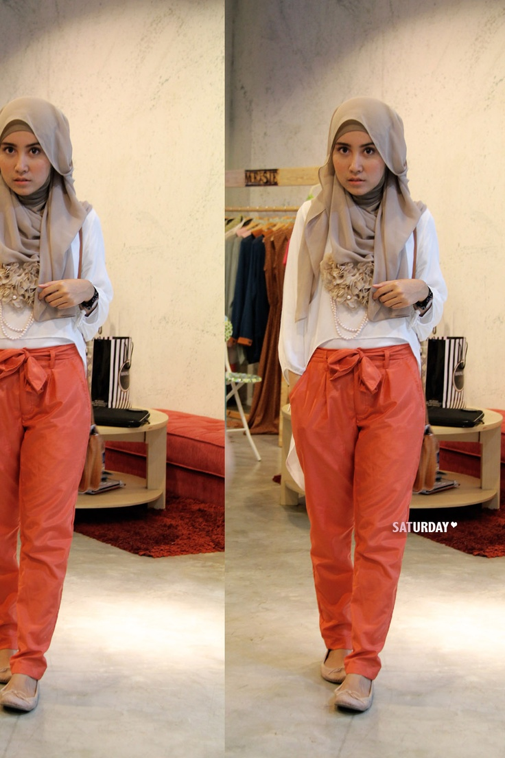 coloured slouchy pants! and a hijab of course. orange-coral ish and beige and white