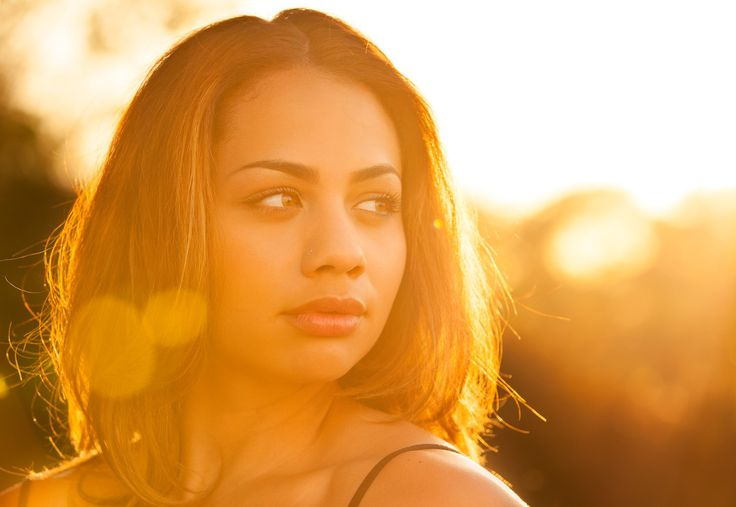 lens flare portrait - Sunset portrait of a young woman.
