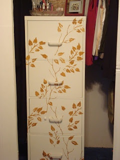 Leaves stenciled onto a filing cabinet, via Pinterest
