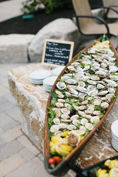 Repurpose an old wooden boat and turn it into a self-serve raw bar, stocked with shrimp, littleneck clams, oysters, and all the accoutrements | Brides.com