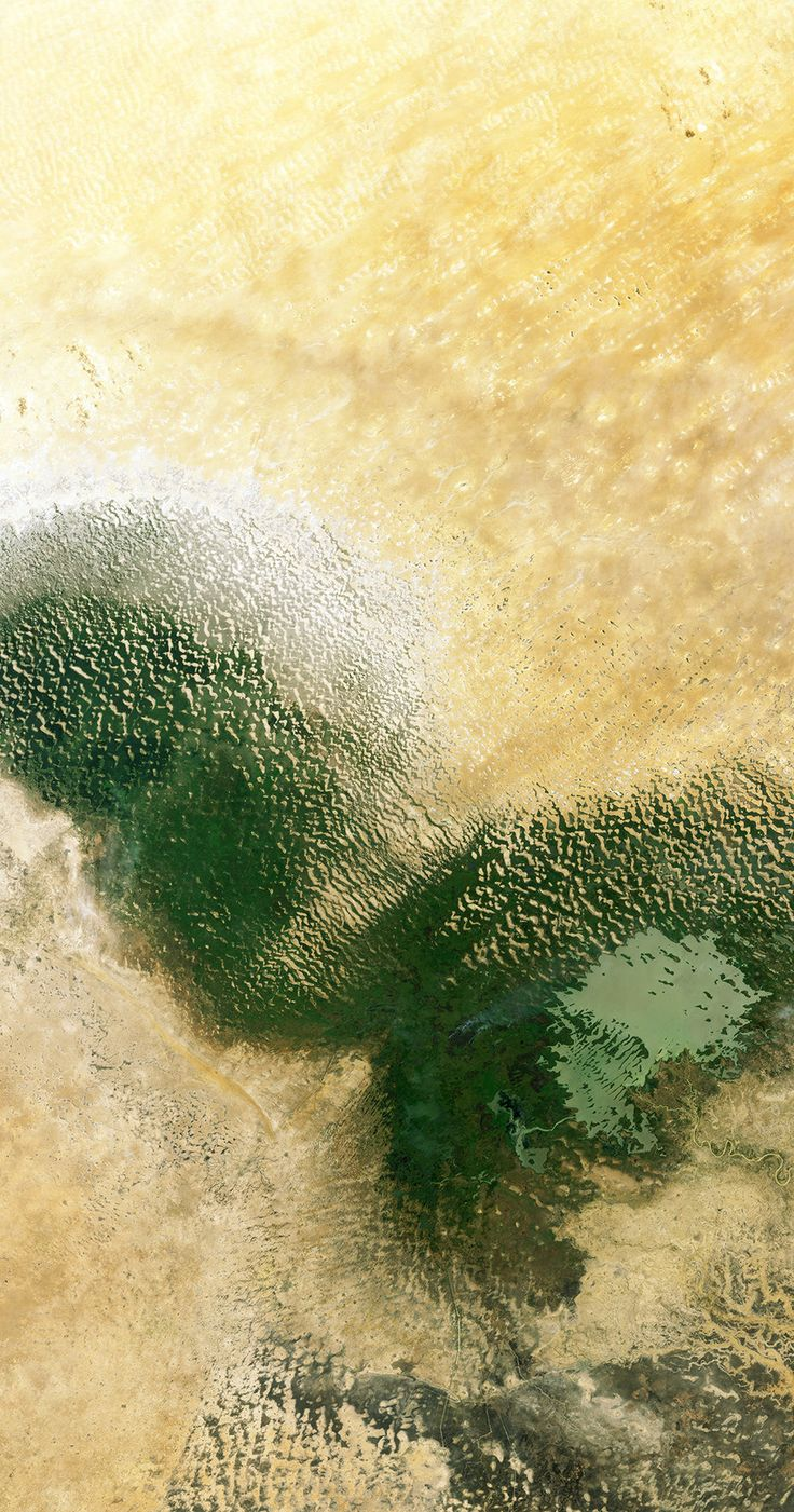 This Landsat-8 image from 4 July 2014 shows Lake Chad in West Africa's Sahel region – a transition zone between the Sahara Desert to the north and savannahs and woodlands to the south. - Credits: USGS/ESA