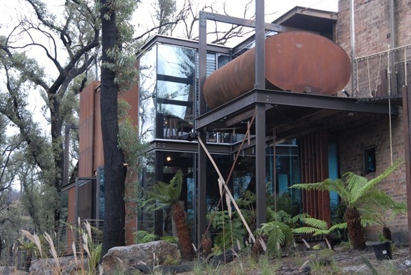 Bushfire House - Grand Designs Australia. I love the old tank, the rust, and how it all blends into the landscapre so beautifully.