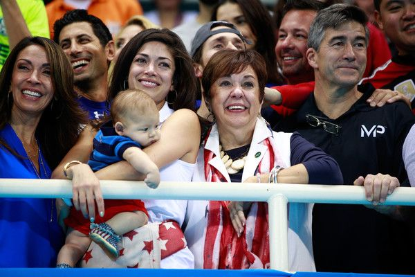 Deborah Phelps Photos Photos - Nicole Johnson, fiancee of Michael Phelps of the Unites States, holds their son Boomer and Debbie Phelps, Michael's mother, celebrate after the Men's 4 x 100m Medley Relay Final on Day 8 of the Rio 2016 Olympic Games at the Olympic Aquatics Stadium on August 13, 2016 in Rio de Janeiro, Brazil. - Swimming - Olympics: Day 8