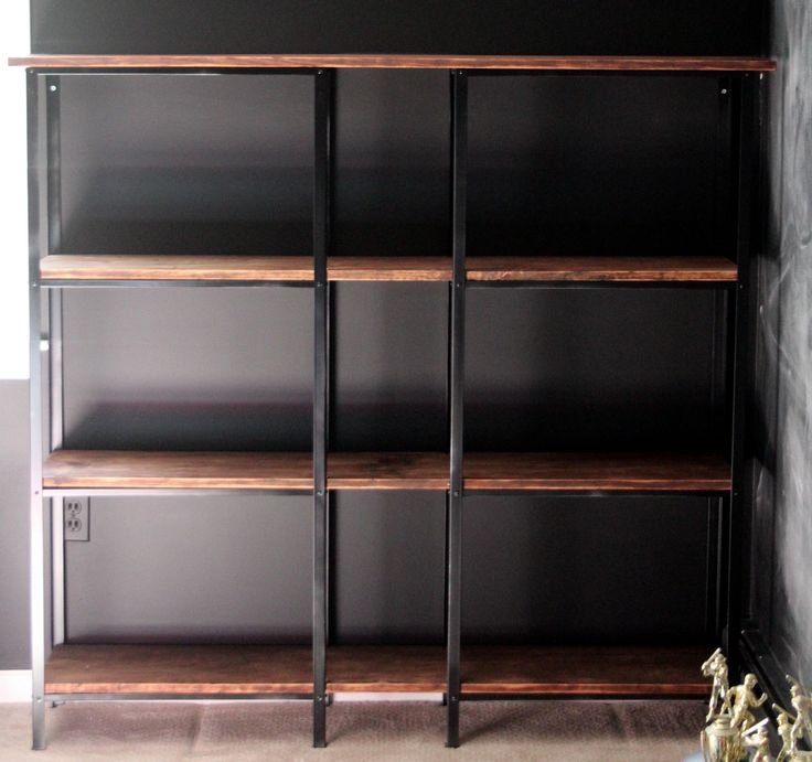 Bubby. Cheap metal shelves turned into high-end bookcase.