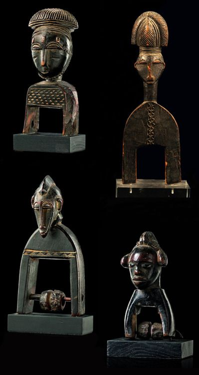 West Africa | Four wooden heddle pulleys from the Ivory Coast.