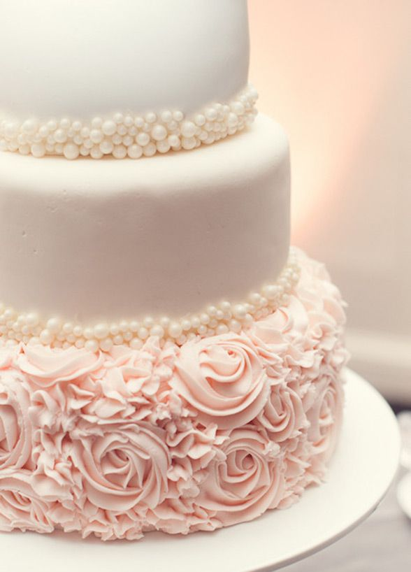 Pearl tiers and pink rose frosting on wedding cake