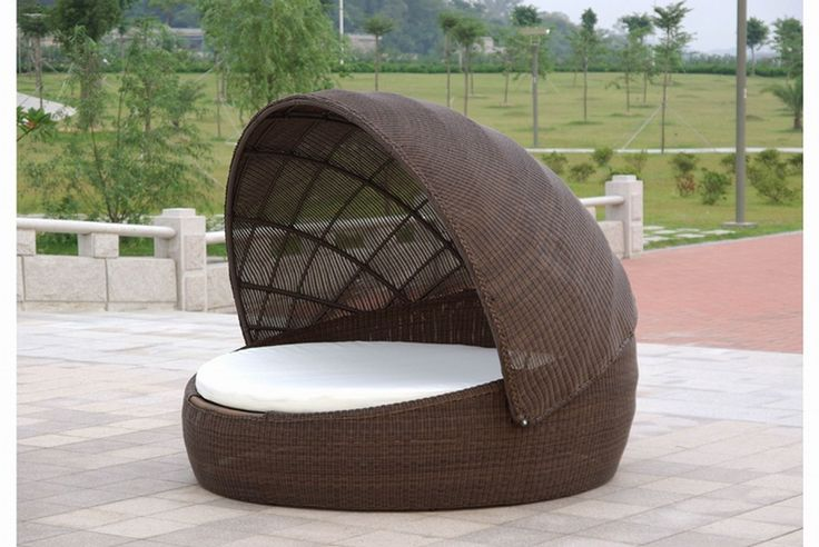 Furniture: Medium Size Seater Dark Brown Rattan Material Rounded Natural Sun Lighting Bright Weather On Large Gray Stone Floor Color Under Whiet Cloud Sky Color Large Dry Green Grass Various Plants: Superb Outdoor Furniture in Beautiful Place