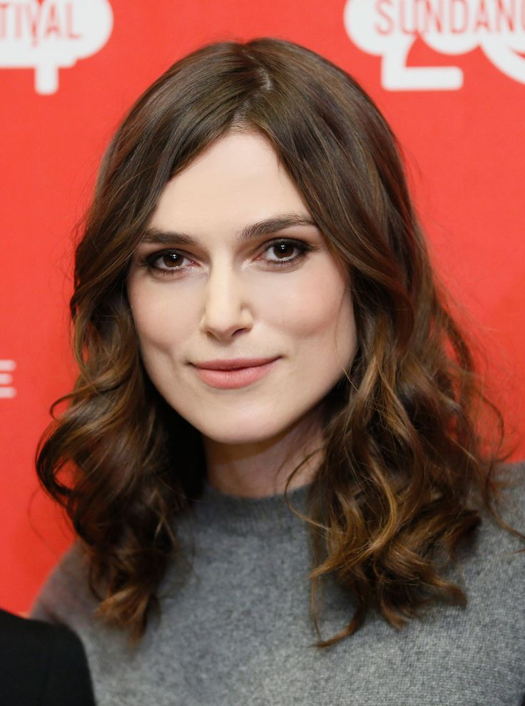 Keira Knightley's Casual And Pretty Sundance Hair: Add styling cream at the base of hair to keep rest o hair soft. After blow drying, use a small curling iron (1-1.5 in.) to create bends (some toward and some away from your face). Finish with smoothing serum (stay away from roots so they don't get greasy) and finish with hairspray.