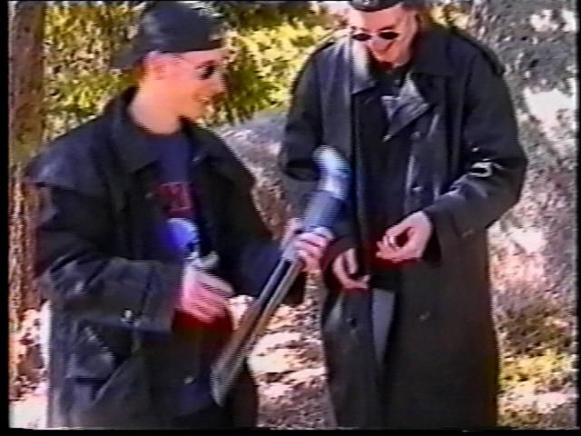 Columbine Massacre: Eric Harris (L) and Dylan Klebold examine a sawed-off shotgun at a makeshift shooting range March 6, 1999 in Douglas County, CO.