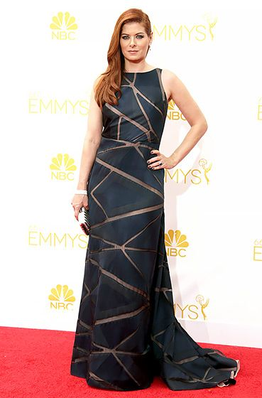 Debra Messing: 2014 Emmys ~ The Mysteries of Laura actress looking stunning in a sleeveless Angel Sanchez gown with sheer slivers throughout, paired with bling by Chopard and a Judith Leiber clutch.