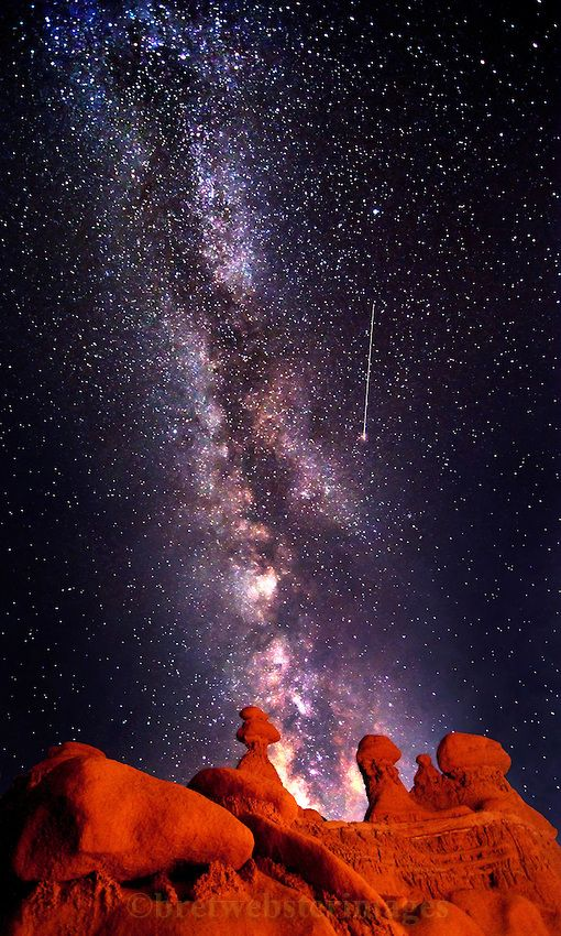 A shooting star is caught in Goblin Valley near the San Rafael Swell in Utah. The Milky Way backs the majestic hoodoos on the ridge by Bret Webster.