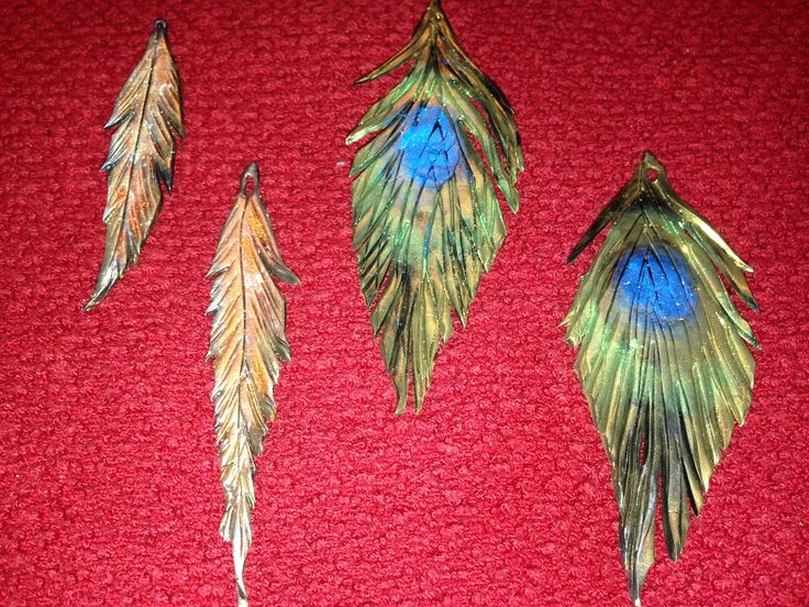 Trying my hand at creating feather jewelry.  These are my first drafts of pendants.  More to come!