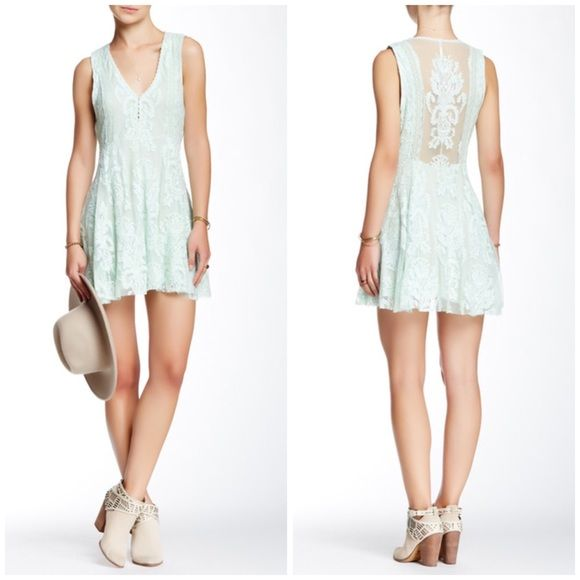 """Free People Reign Over Me sea green dress - V-neck - Sleeveless - Front hook-and-eye closure - Side hidden zip closure - Allover lace with sheer details - Approx. 32"""" length - Imported Fiber Content: Base: 100% nylon Embroidery: 100% cotton Lining: 100% rayon Care: Hand wash cold Fit: this style fits true to size.  Bundle for even bigger savings! Offers welcome. No trades. Free People Dresses Mini"""