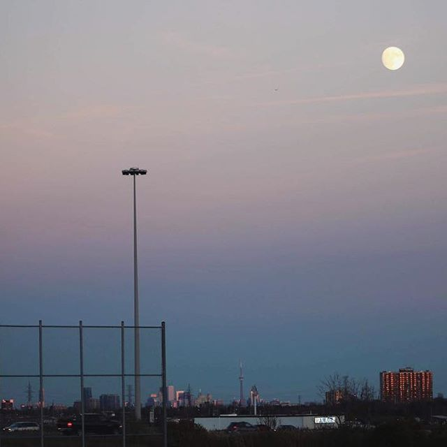 Sunsets and a full moon. Look closely to see the CN Tower in the distance.