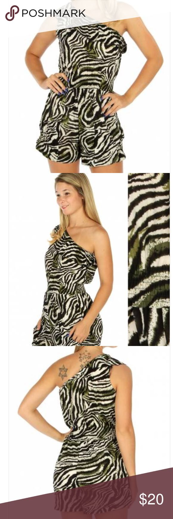 One shoulder tiger green romper This romper features a ruffled one shoulder style and a tiger print. 100% Polyester Weight 6.4 oz Other