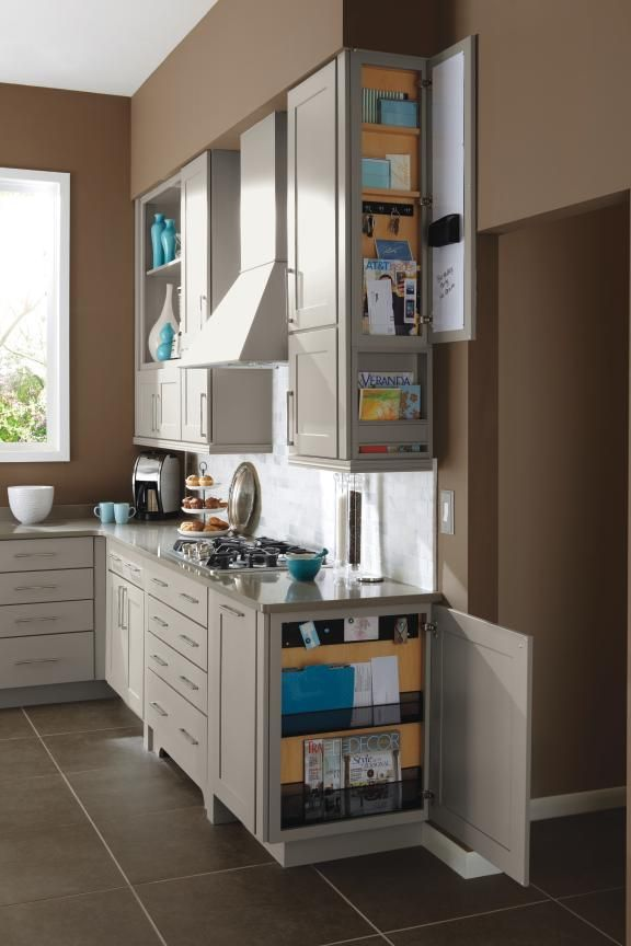Store and organize keys, magazines, mail, and other small items in Diamond Cabinetry's message centers to keep countertops free of clutter. Features magnetic whiteboard, key hooks, and pencil holder