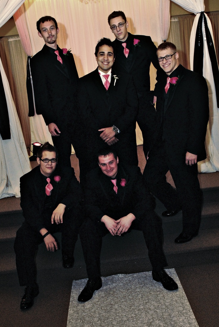 Have the groom differentiate his outfit from groomsmen. Groomsmen wore Calvin Klein suits with black vest and black shirt, and pink tie. Groom wore ivory shirt with black vest and pink tie. Grooms shirt had wingtip's versus folds. You want your groom to standout.