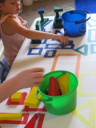 using tape on a table to make the shape then the child matches the block to the correct shape. could also be done on boards to work on the floor as puzzle