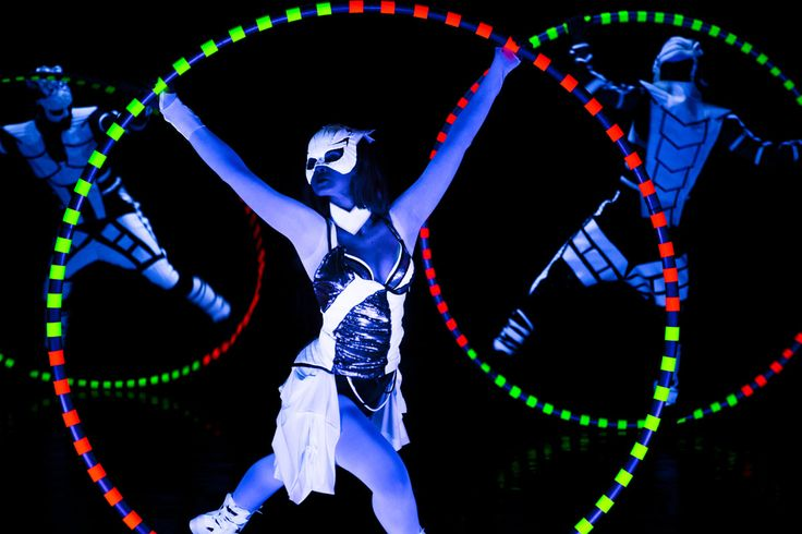 Cyr Wheel performance - one girl and two boys in black light show Crystal UV Light - Anta Agni. http://antaagni.com/crystal-light-show/