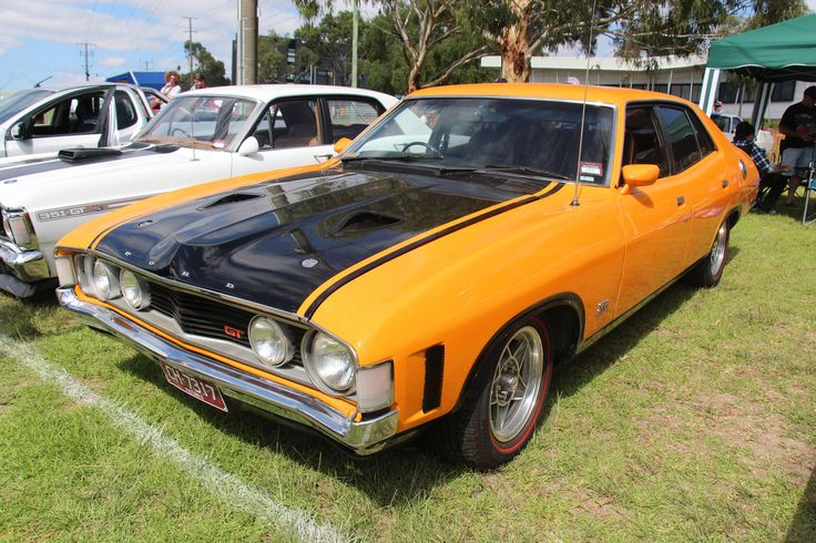 https://flic.kr/p/DtykEy | 1972 Ford XA Falcon GT Sedan | Yellow Fire.  The XA Falcon Sedan was built From March 1972- Sept 1973. (Hardtop from July 72) First Fully Australian Designed Falcon, the XA got a much softer and smoother, more aerodynamic body, covering only a mildly revised floor pan and mechanicals, inside a new wrap around style dash and high back front seats. Big news was the 2 door Hardtop was reintroduced.  The GT, mechanically very similar to the XY GT, got functional…