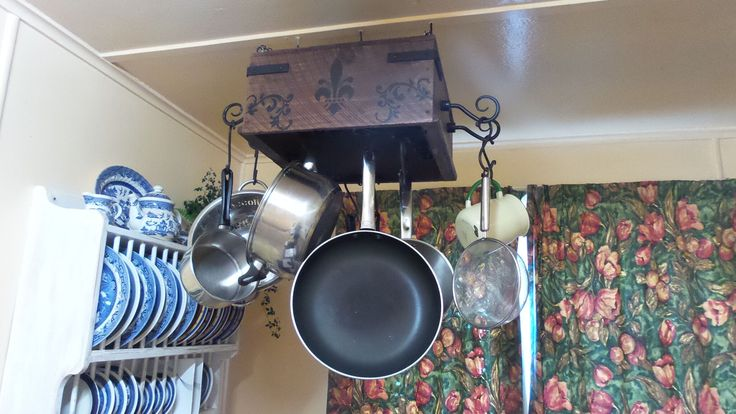 Rustic Gothic Pot Rack I made from an old wooden box that was in my folks cellar for years , turned out great :-)