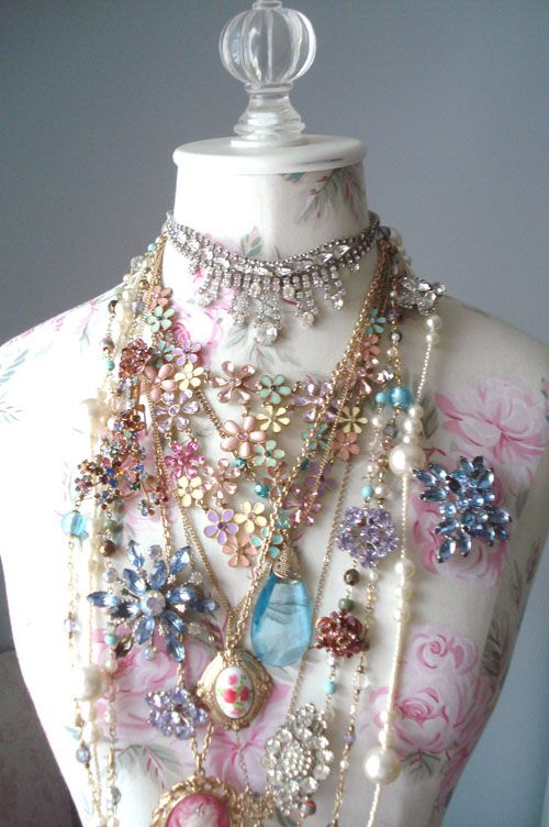 Just want all of this. Vintage pieces on floral dress form.