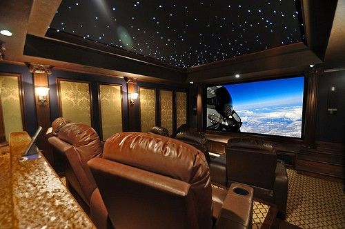 Custom Home Theater with faux starry night ceiling. The twinkling stars are really cool in a dark theater...