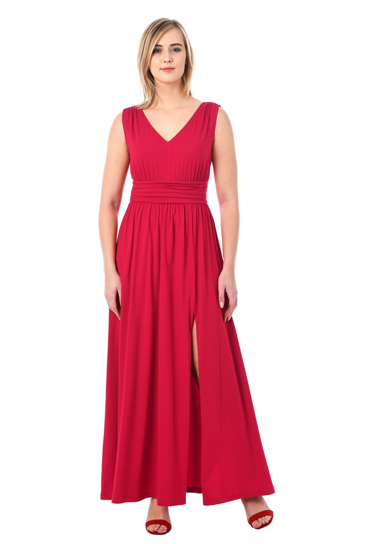 Our cotton jersey knit dress is styled with a low V-neck, pleated bodice, wide banded waist with ruched pleating and a full skirt with a high side slit or a flirty show of leg.